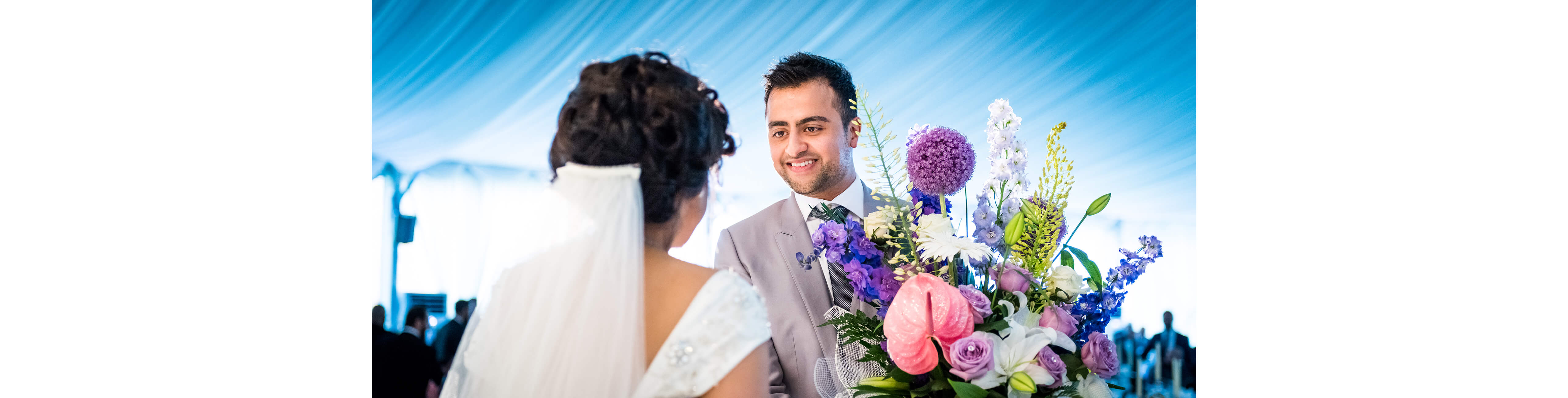 Groom-greets-Bride-with-bouquet