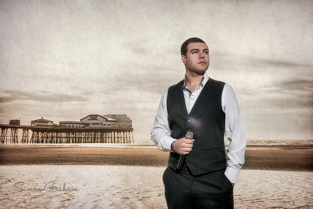 Lee Mobey with the North Pier on the seafront in Blackpool.
